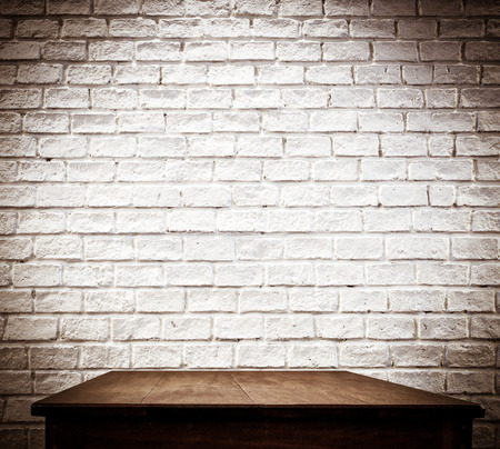 brick background: white brick wall and wooden table.