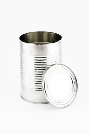 Open Tin can and cap on white background  photo