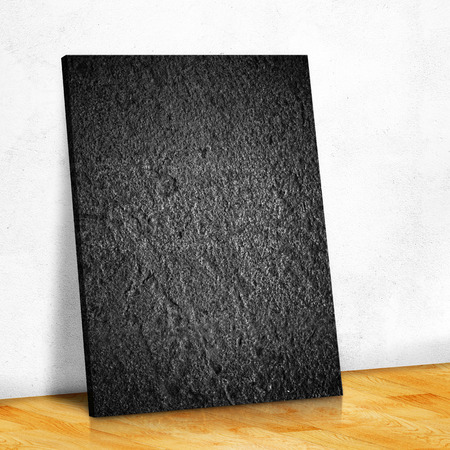 black stone: Black stone on the white wall and the wood parquet floor,Mock up for your content