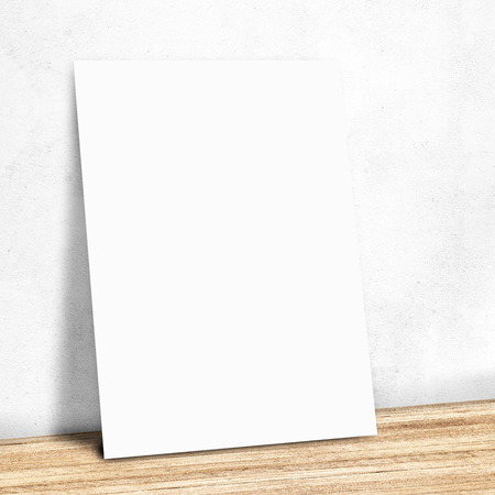 poster presentation: blank white paper on the white wall and the wooden floor,Mock up for your content Stock Photo