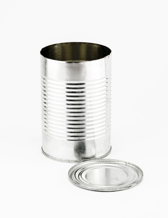 Open Tin can and cap on white background. photo