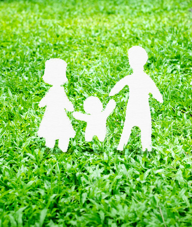adopting: Paper Family icon on green grass.