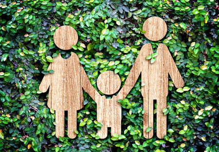 Family wood icon on green leaf wall,Eco concept  스톡 콘텐츠