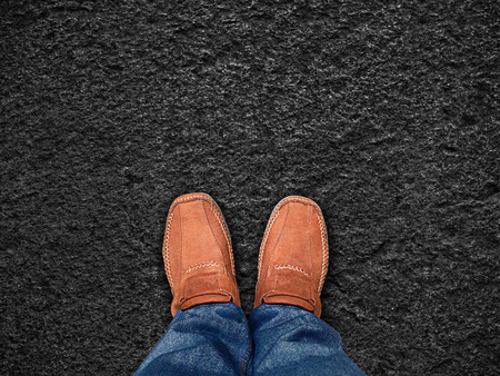 firm: top view,Foot stand on black sand stone ,Leave space for your content  Stock Photo