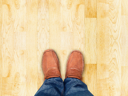 floor standing: top view,Foot stand on wood parquet sand stone ,Leave space for your content  Stock Photo