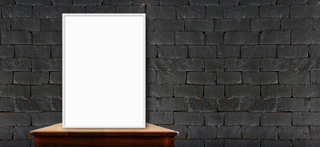 blank poster on wood table at black brick wall,perspective background photo
