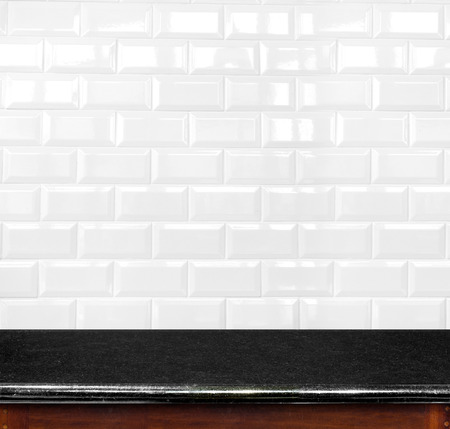 Empty black marble table and ceramic tile brick wall in background. product display template. photo