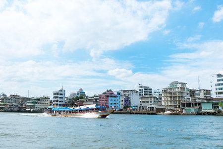 riverside landscape: Bangkok ,Thailand-July 24 : chao phraya riverside landscape with express boat and old town building, Bangkok, Thailand.