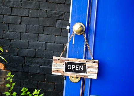 open label hanging on blue door in garden photo
