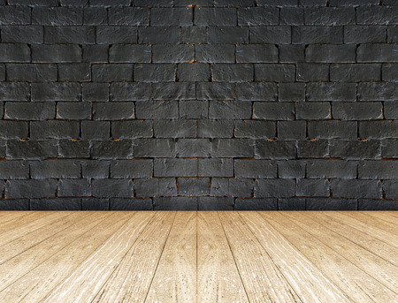 black brick wall and wooden floor photo