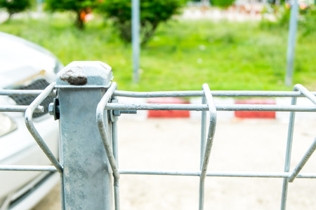 no boundaries: Wire fence at road and red line parking.