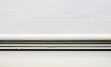 Close up wall with baseboard moulding,interior background. photo