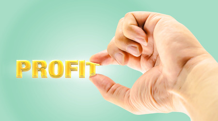 factor: Mans Finger picking Profit word on light green background,Business concept,one of business factor