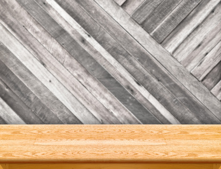 wood table at blurred colorful plank wooden wall in background,Template for display your product photo