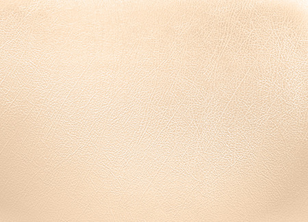 Cream colored leather texture background