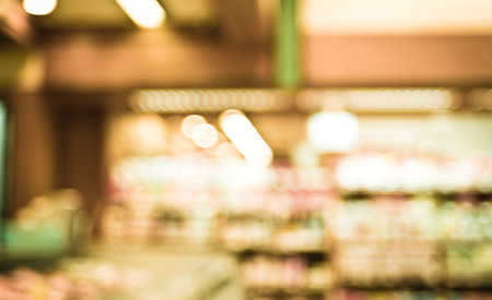 supermarket: Supermarket store blurred background with bokeh,defocused light in store. Stock Photo