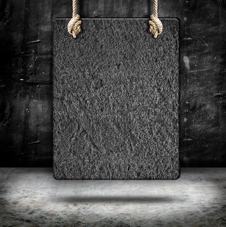 Hanging sand stone frame with rope at concrete wall and cement floor,Mock up for add your content,business presentation template photo