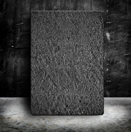 Sand Stone poster frame in Empty Grunge concrete wall and cement floor photo