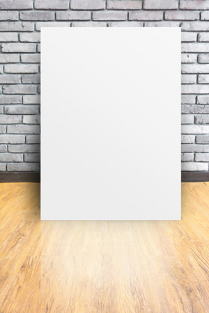 white Poster at Empty interior perspective with brick wall and wood parquet photo