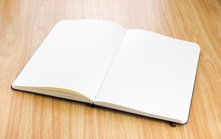 open spaces: Blank open notebook on wood table,business template.