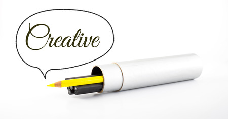 yellow pencil outstanding from black pencil with speech bubble and word \ creative \ on white background, business concept Stock Photo