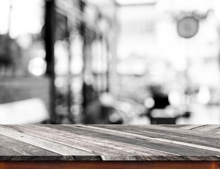 food products: Empty wood table top with coffee shop blur with bokeh background,Product display template.
