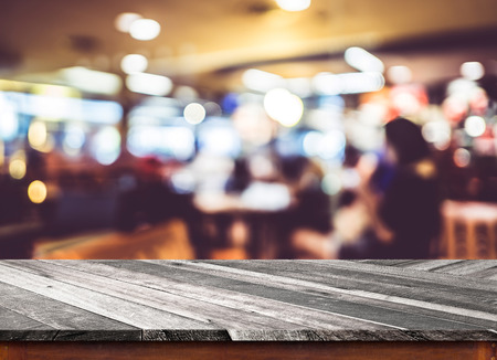 blurry: Empty wood table top with coffee shop blur with bokeh background,Product display template.