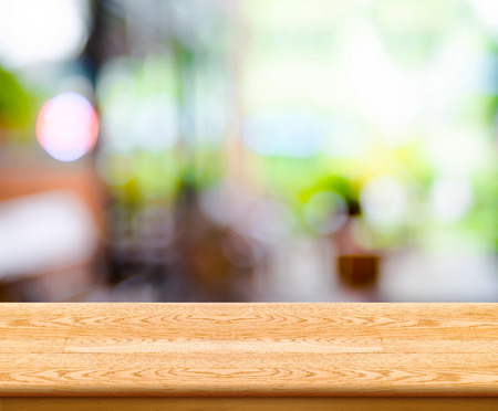 kitchen counter top: Empty wood table top with coffee shop blur with bokeh background,Product display template.