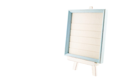 layer style: Light blue country rustic style wood frame with canvas layer on white wood easel isolated on white background,Template for add photo