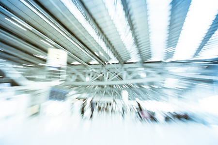 light zoom: Blurred motion background : Traveler at airport terminal Check-in departure blur background with bokeh light. Stock Photo