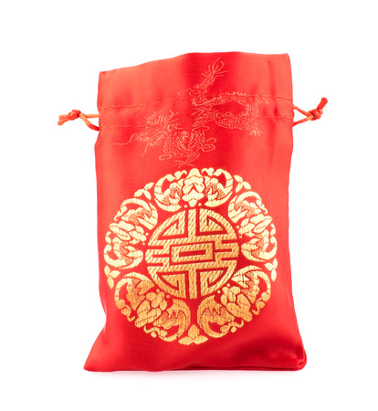 fabric bag: Open Red fabric bag or ang pow with Chinese style pattern on white background.. Stock Photo