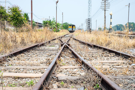 vacant: Vacant Rail way switch track with yellow die grass. Stock Photo