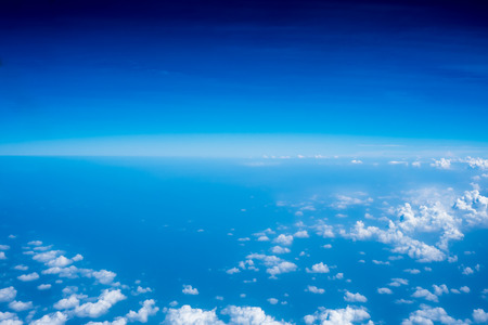 skyscape: Aerial view of Blue sky and Cloud Top view from airplane window,Nature background. Stock Photo