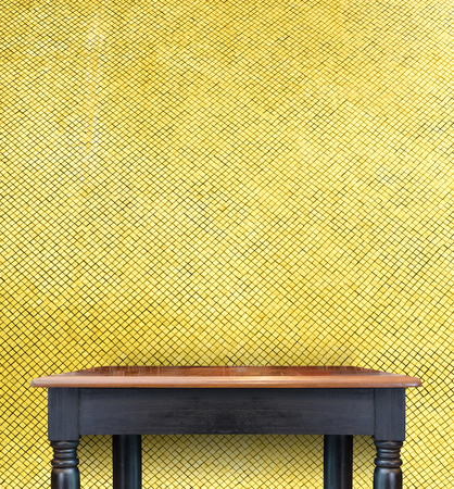 mosaic tiles: Empty Vintage black Wooden Table top at golden mosaic tiles wall,Template mock up for display of your product.