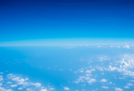 Aerial view of Blue sky and Cloud Top view from airplane window,Nature background. Stock Photo