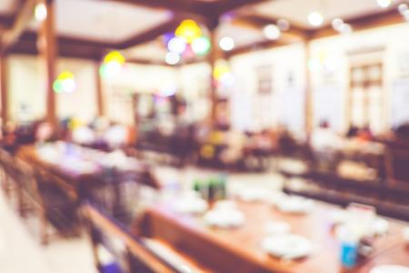 Blurred background : Customer at restaurant blur background with bokeh,vintage filter.