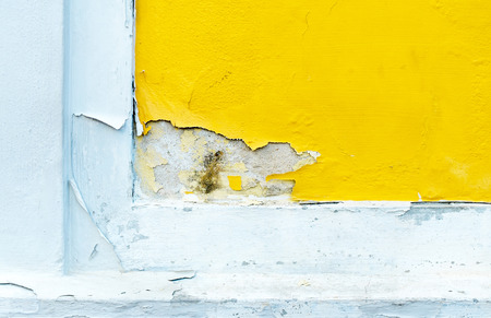 erode: yellow erode painted concrete wall,grunge rough texture background.