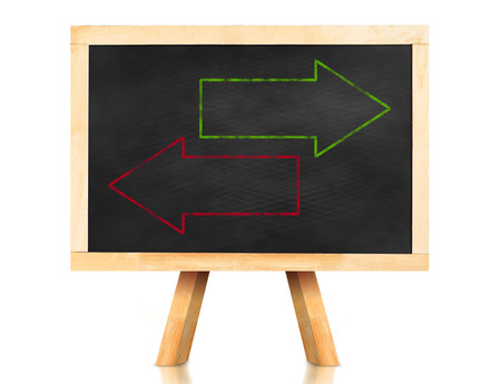 oppositional: Blank green and red arrow in reverse way on blackboard with easel and reflection on white background,Template to adding your text. Stock Photo