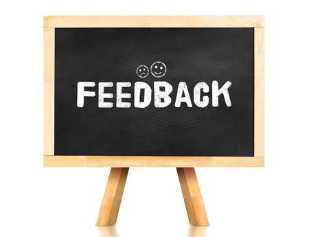 feed-back mot et l'émotion icône sur tableau avec chevalet et de réflexion sur fond blanc, Business concept. Banque d'images