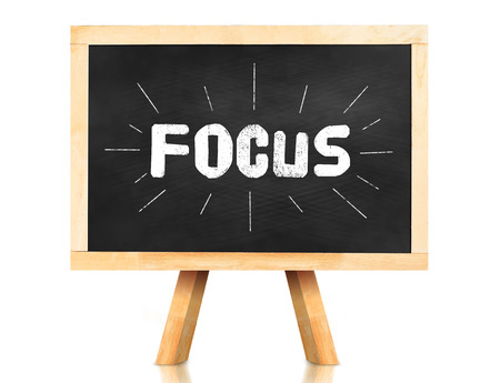 emphasis: Focus word with emphasis line on blackboard with easel and reflection on white background,Business concept.