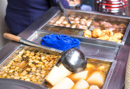entrails: Chinese street food ,Boiling of entrails with soup. Stock Photo