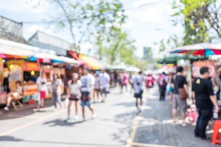 Blurred background : people shopping at market fair in sunny day, blur background with bokeh. Archivio Fotografico