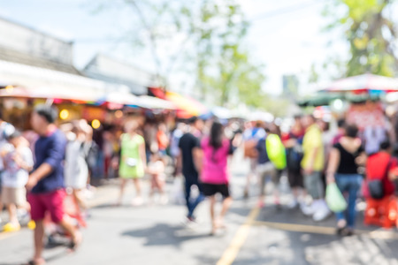 Blurred background : people shopping at market fair in sunny day, blur background with bokeh. Stock Photo
