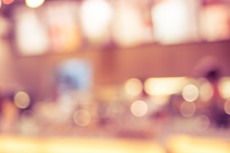 Blurred background : Customer at coffee shop blur background with bokeh,vintage filter. Banque d'images