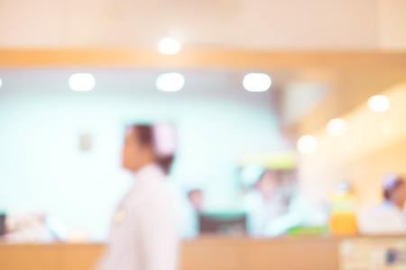 medical light: Blurred background : Vintage filter nurse at hospital counter.