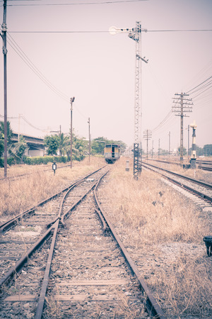 vacant: Vintage filter : Vacant Rail way switch track with yellow die grass. Stock Photo