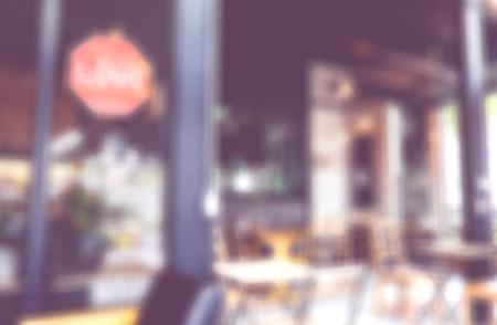 green door: Blurred background : Vintage filter inside coffee shop. Stock Photo