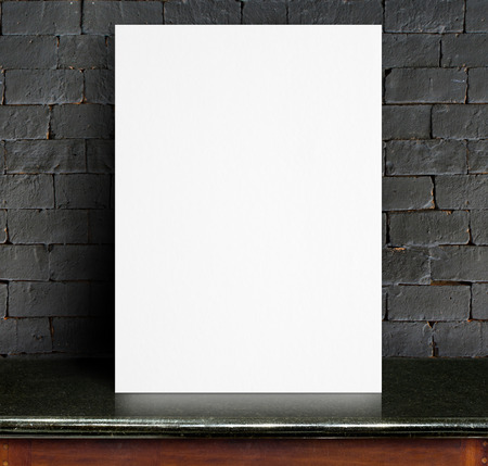 old stone wall: Black White paper poster lean at black brick wall and marble table,Template mock up for adding your text.