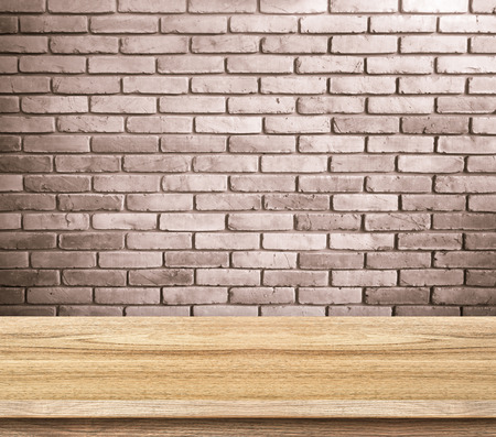 red wall: Empty wood table and red brick wall in background. product display template