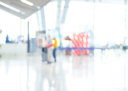 Blur background of Terminal Departure Check-in at airport with bokeh. 版權商用圖片